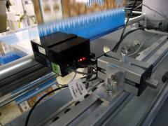Inkjet coder printing on moving film.