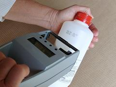 Marking round bottle manually with inkjet